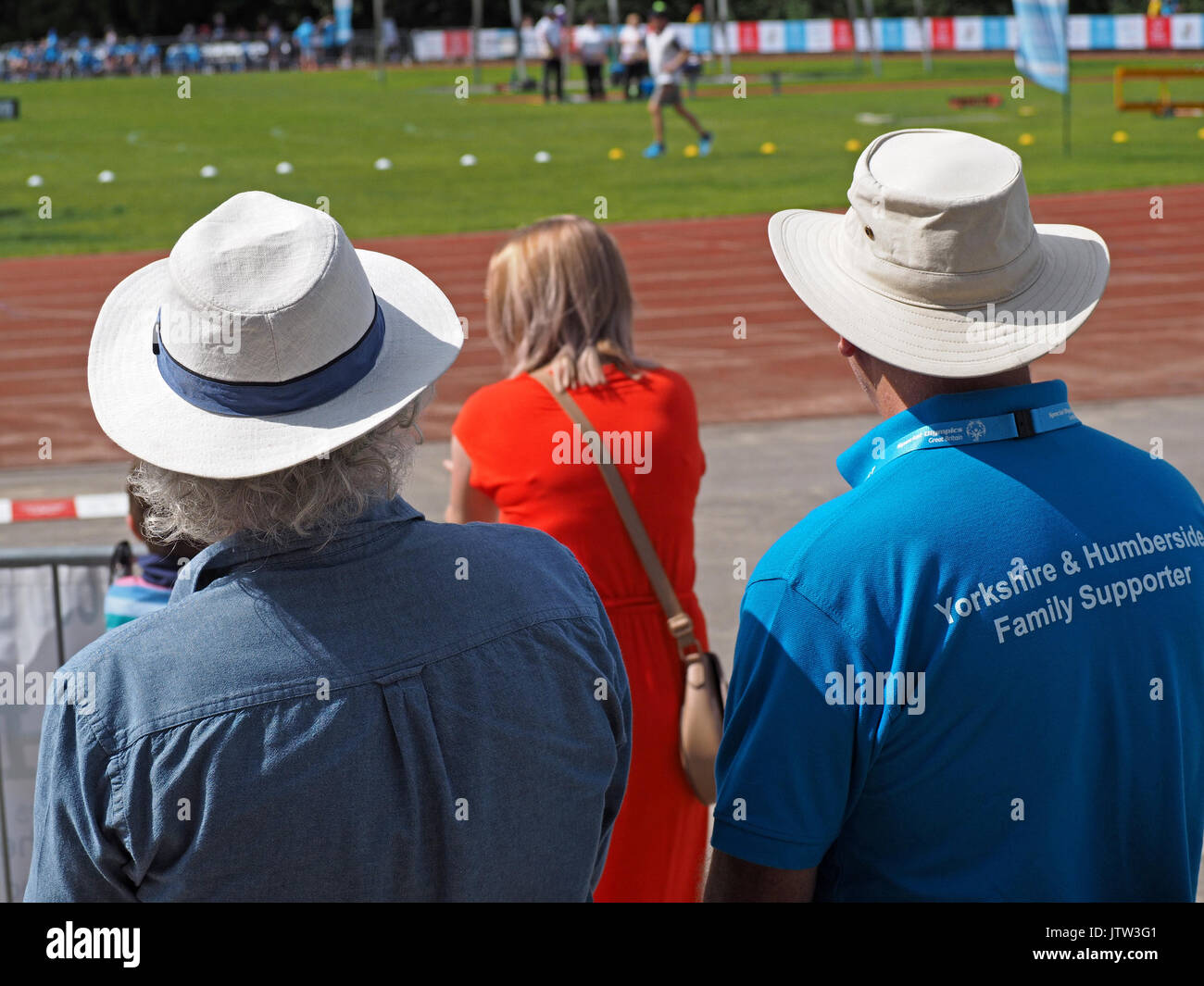 Sheffield, UK. 10th August, 2017. Spectators in sunhats watching athletics at Special Olympics National Games in - Stock Image
