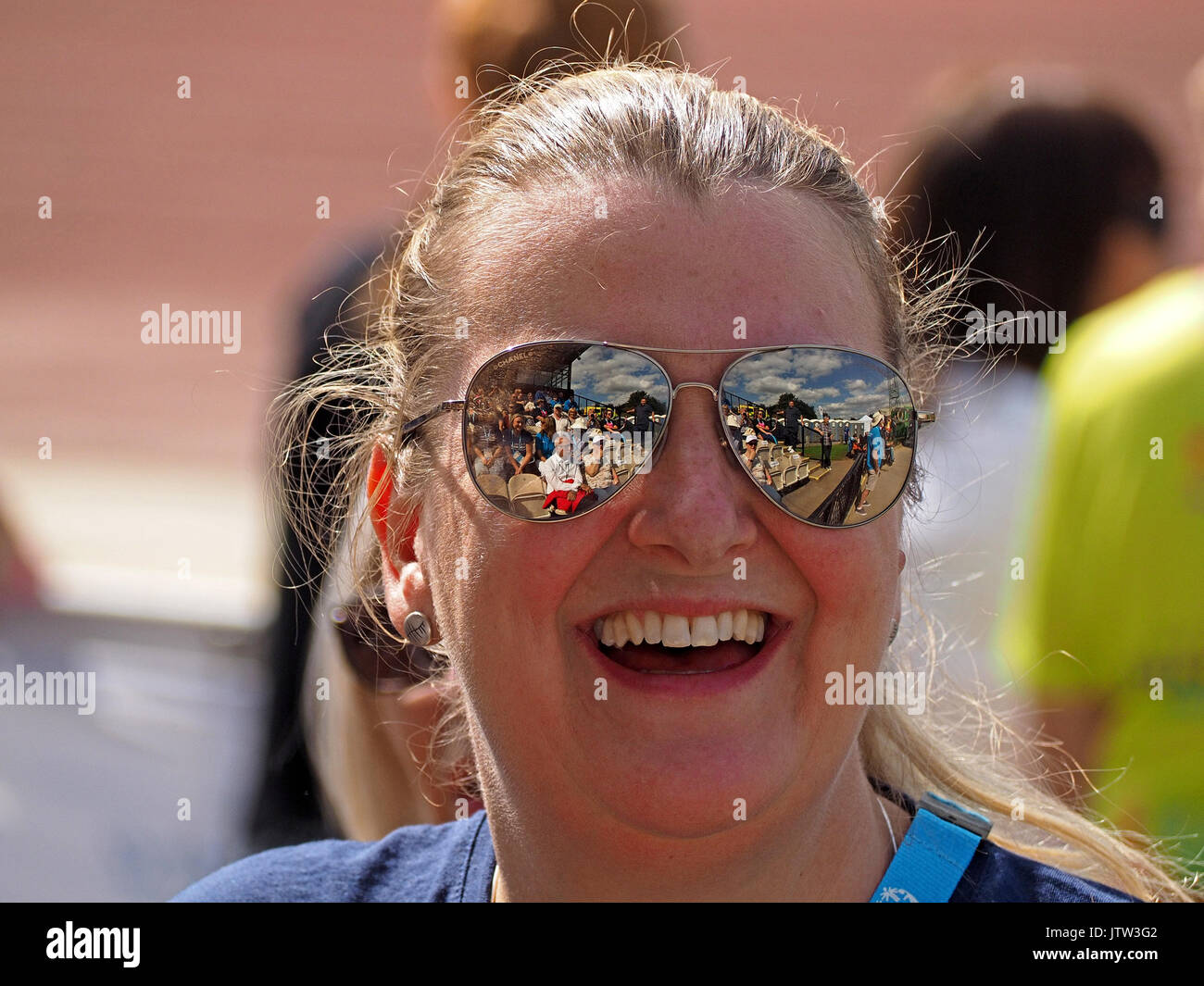 Sheffield, UK. 10th August, 2017. Spectators refelected in sunglasses of one supporter at Special Olympics National - Stock Image