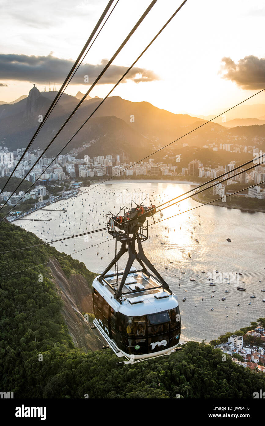View of Sugar Loaf Mountain cable car with Botafogo Bay during sunset, Rio de Janeiro, Brazil - Stock Image