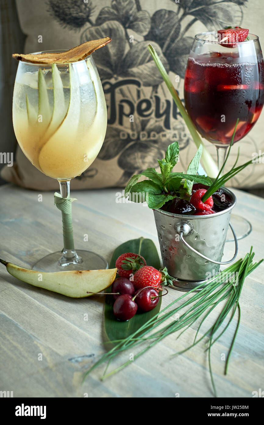 Refreshing sangria or punch with fruits in glass and pincher jpg - Stock Image