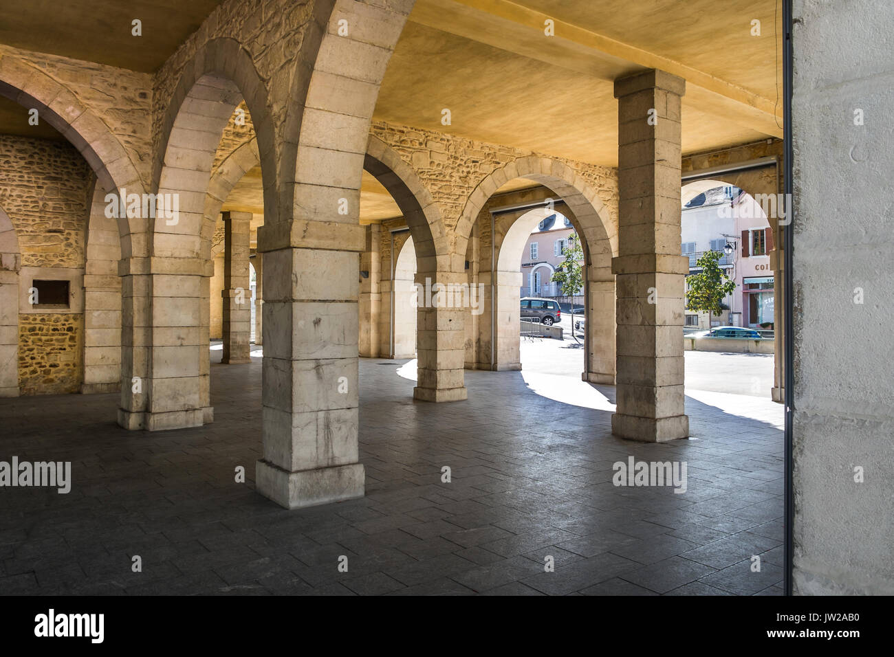 Arched market place under town hall building, Monein, Pyrénées-Atlantiques, France. - Stock Image