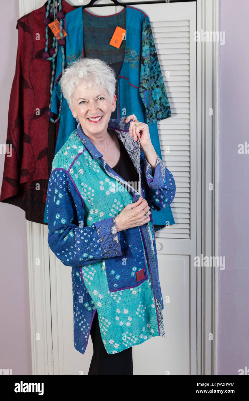 40f56678ef9b Attractive Senior Woman Trying on Designer Clothes