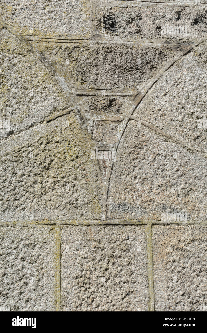 Section of stone wall with arced stonework. - Stock Image