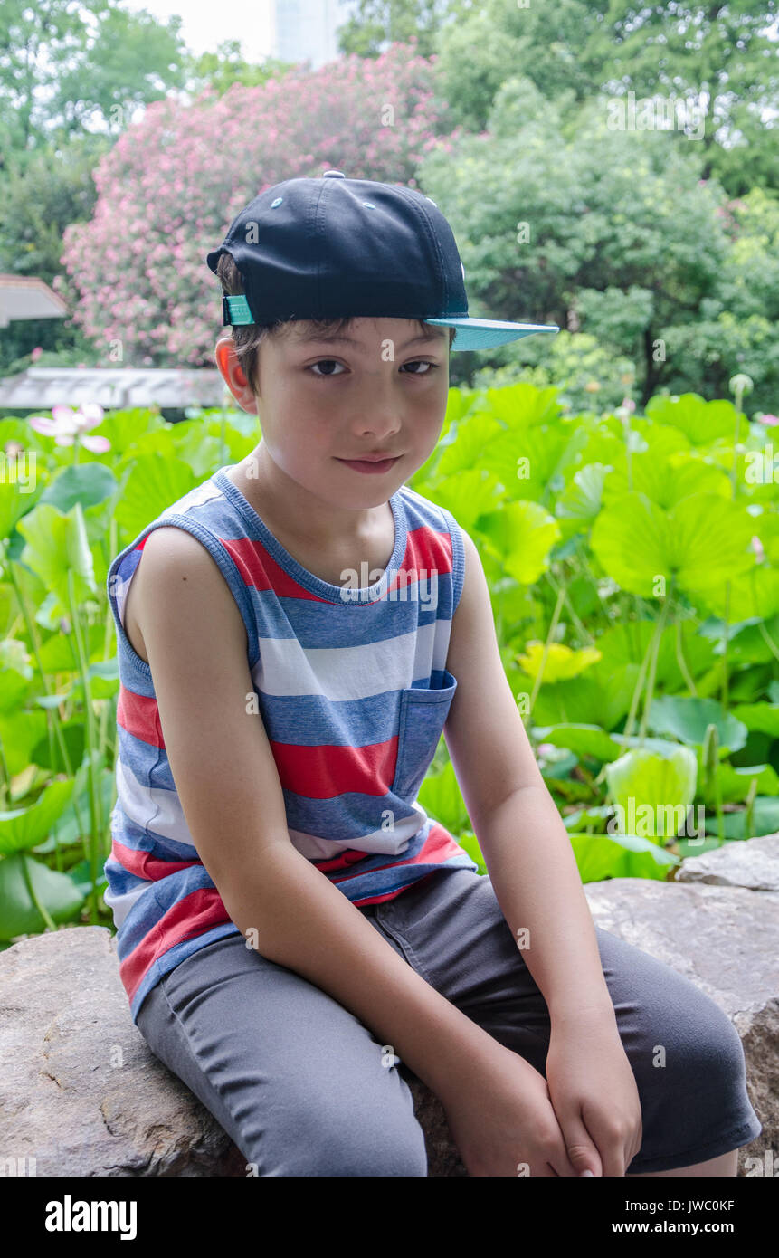 A portrait of a young boy in The People's Park in Shanghai, China.
