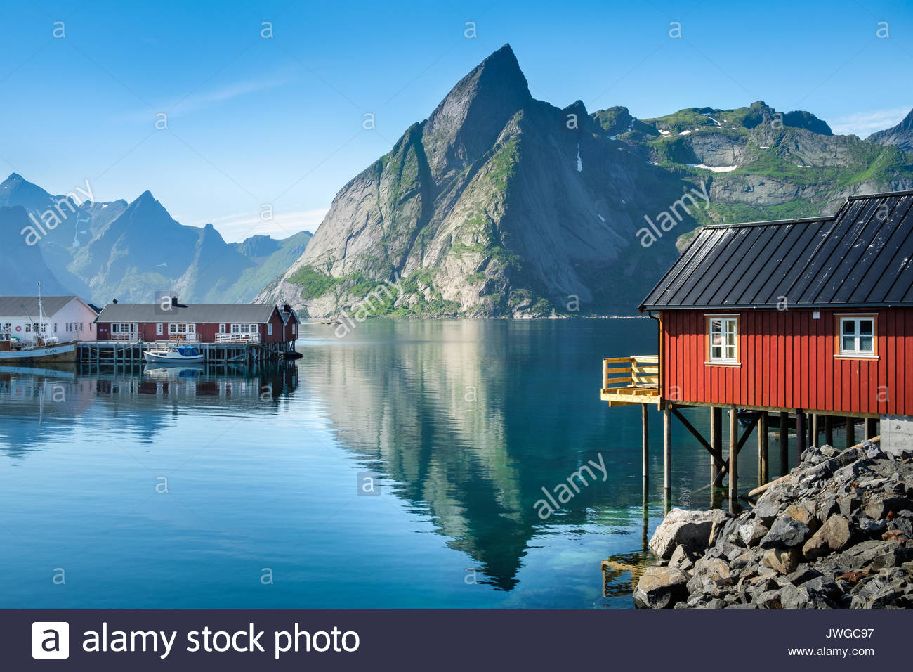 Scenic view from idyllic village with mountains at bright summer day in Hamnoy, Lofoten, Norway - Stock Image