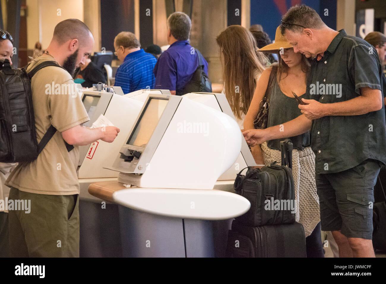 Delta Air Lines Passengers At Atlanta International Airport Using