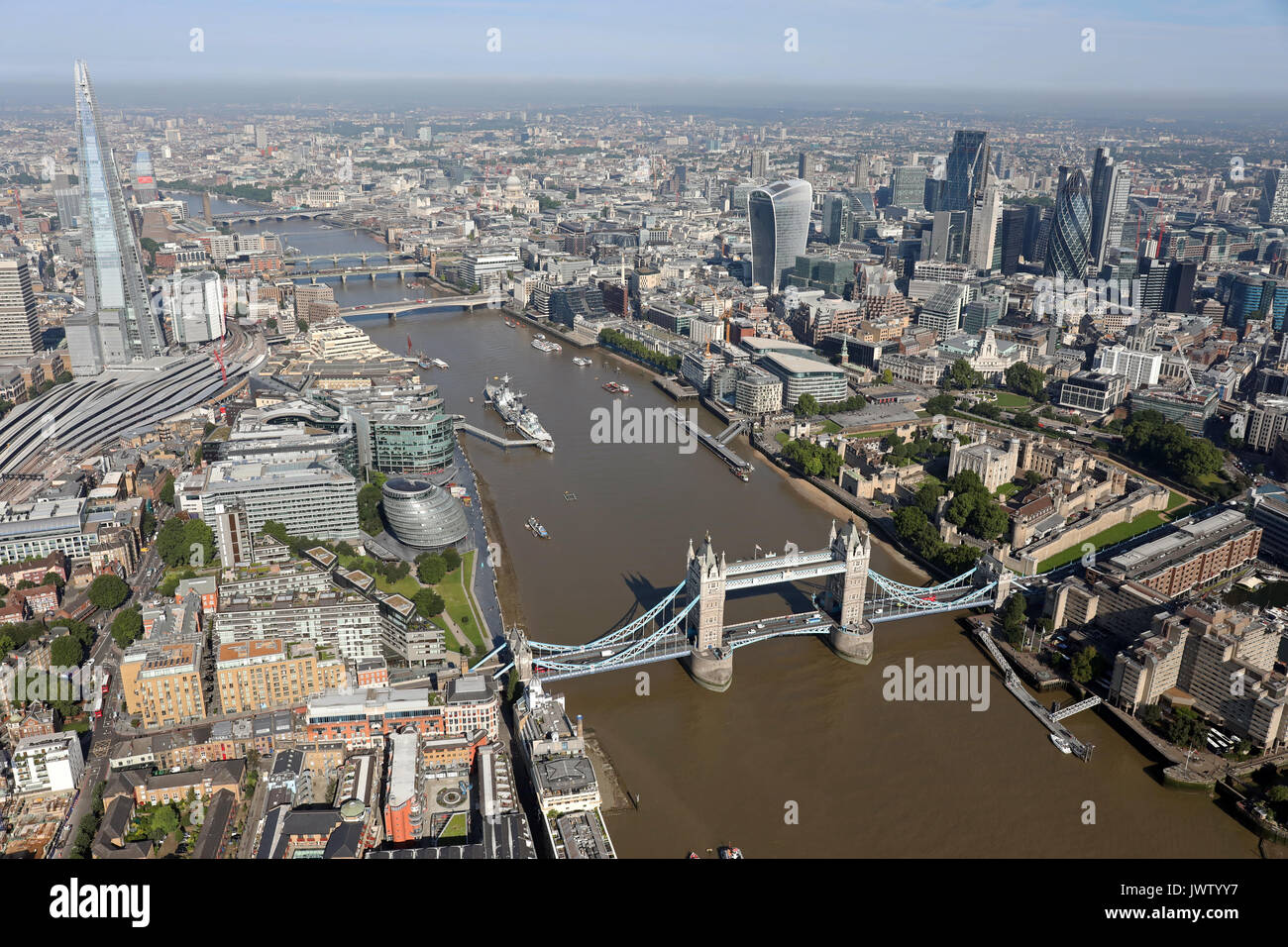 aerial view of Tower Bridge, Shard, Thames, & City of London skyline - Stock Image