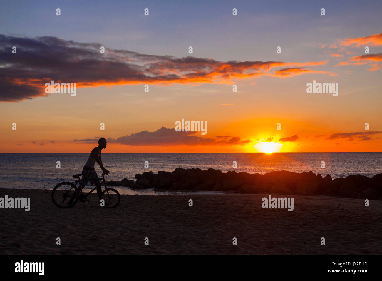 a-young-mam-pushes-his-bicycle-along-the