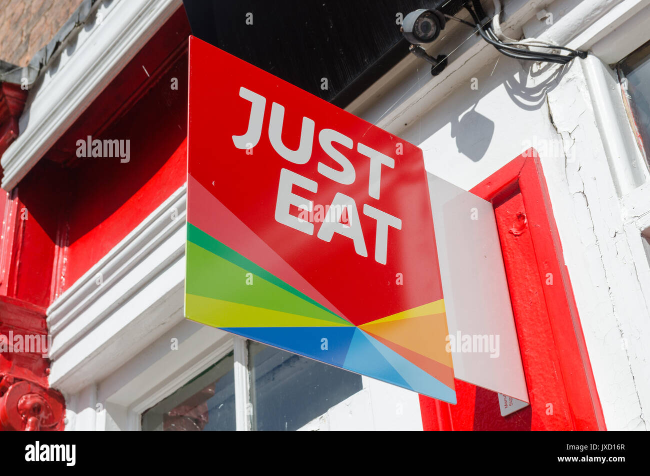 Just Eat sign above takeaway Stock Photo