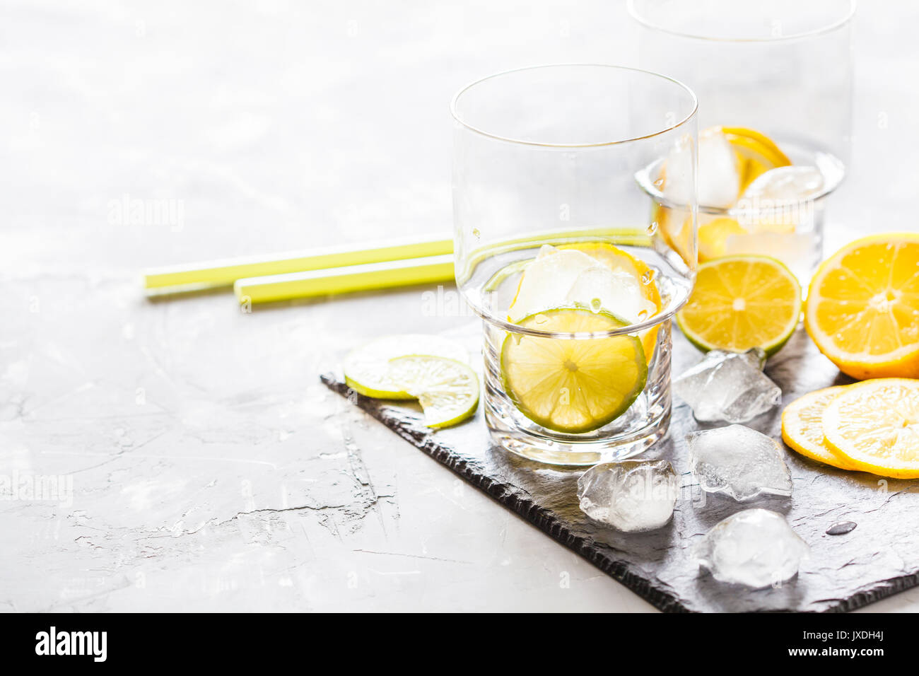 Empty glasses on a slate for drinks. - Stock Image