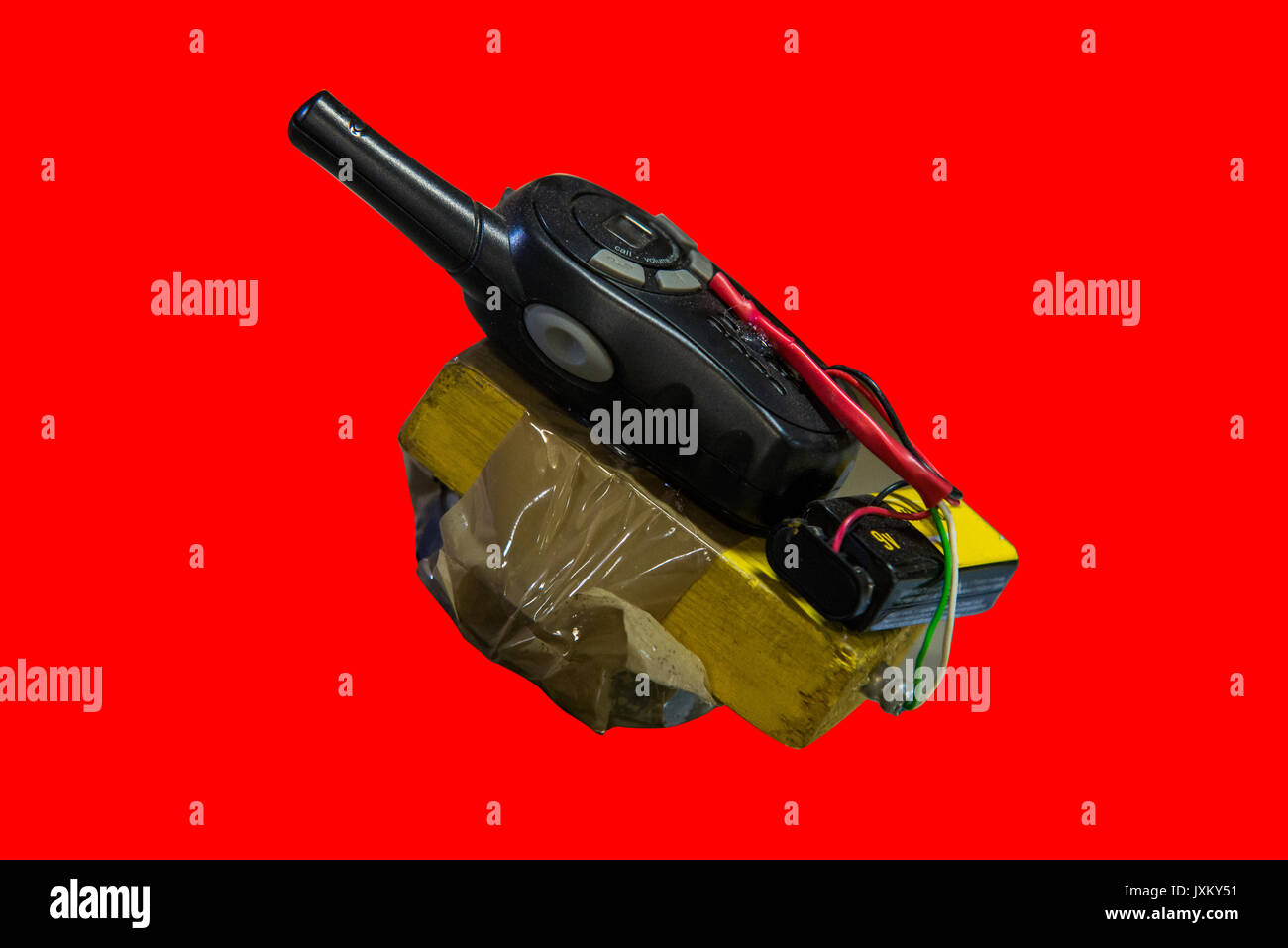 dangerous terrorist timed bomb on red background - Stock Image