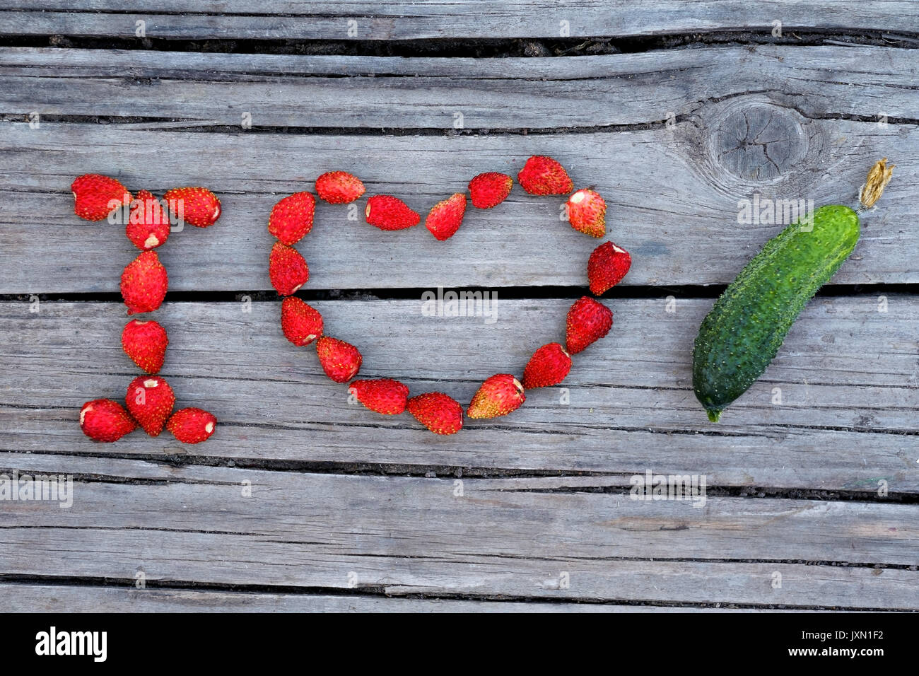 Text I love cucumber made from red strawberry - Stock Image