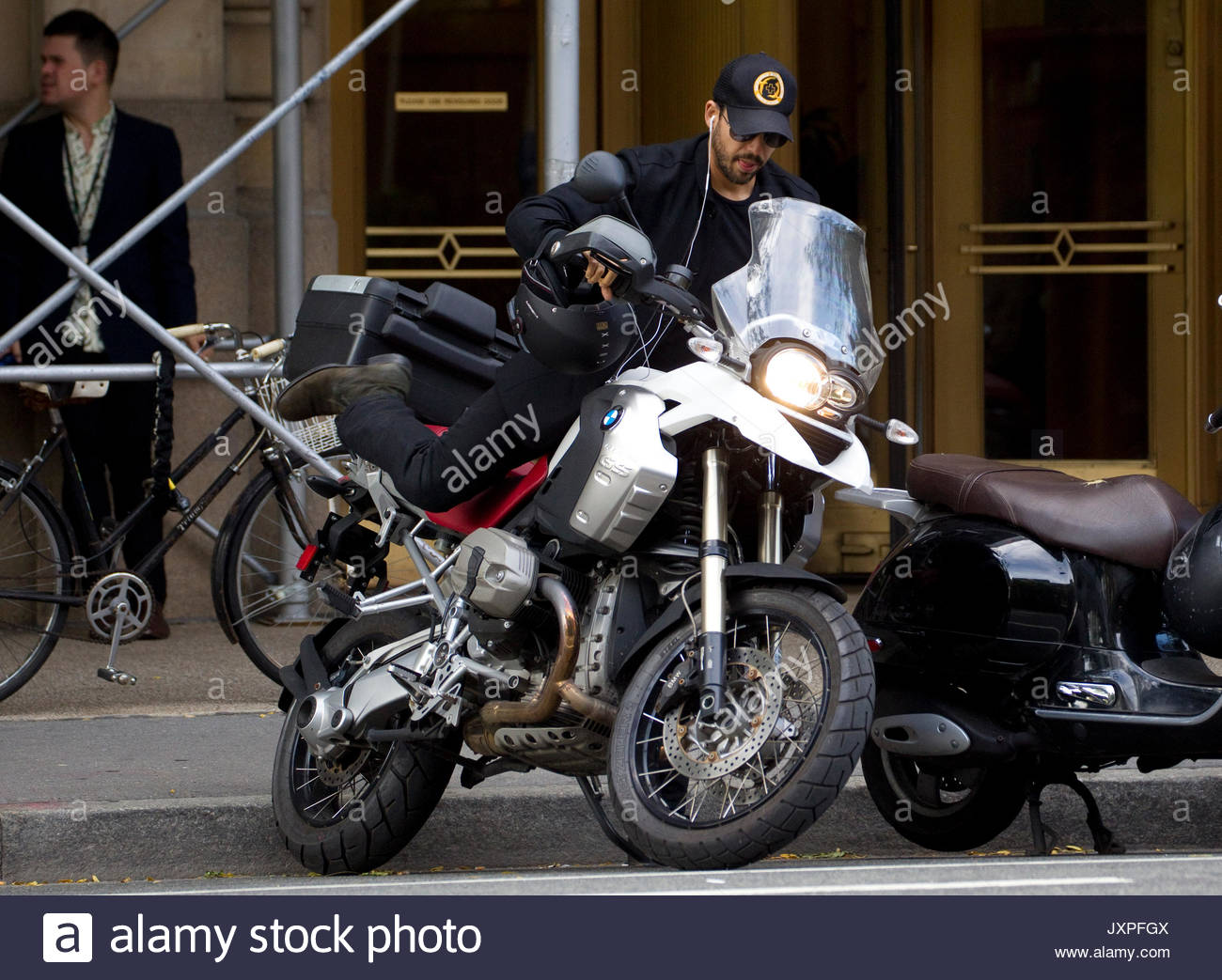 David Blaine. Magician David Blane parks his motorbike in New York's West Village. The stuntman went without - Stock Image
