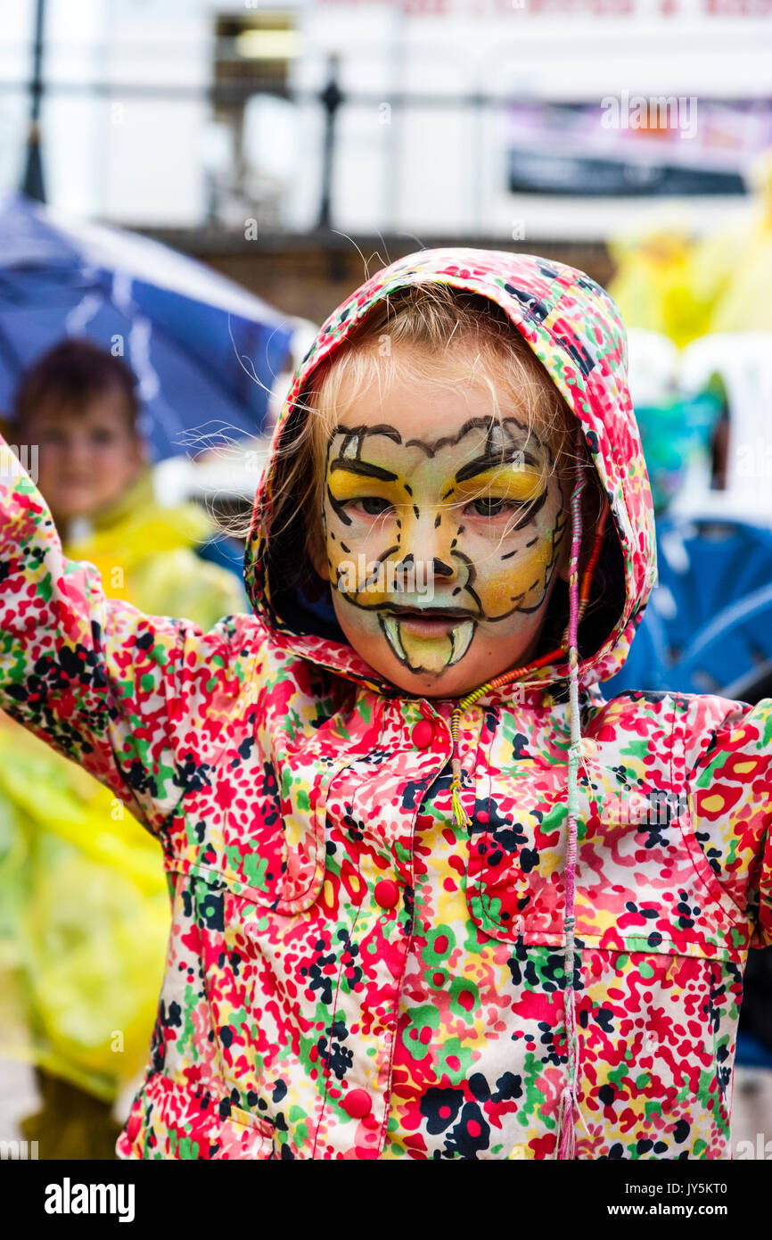 England, Broadstairs folk week. Little blonde child, girl, around 5 or 6 years old, with face painted like a dragon. - Stock Image