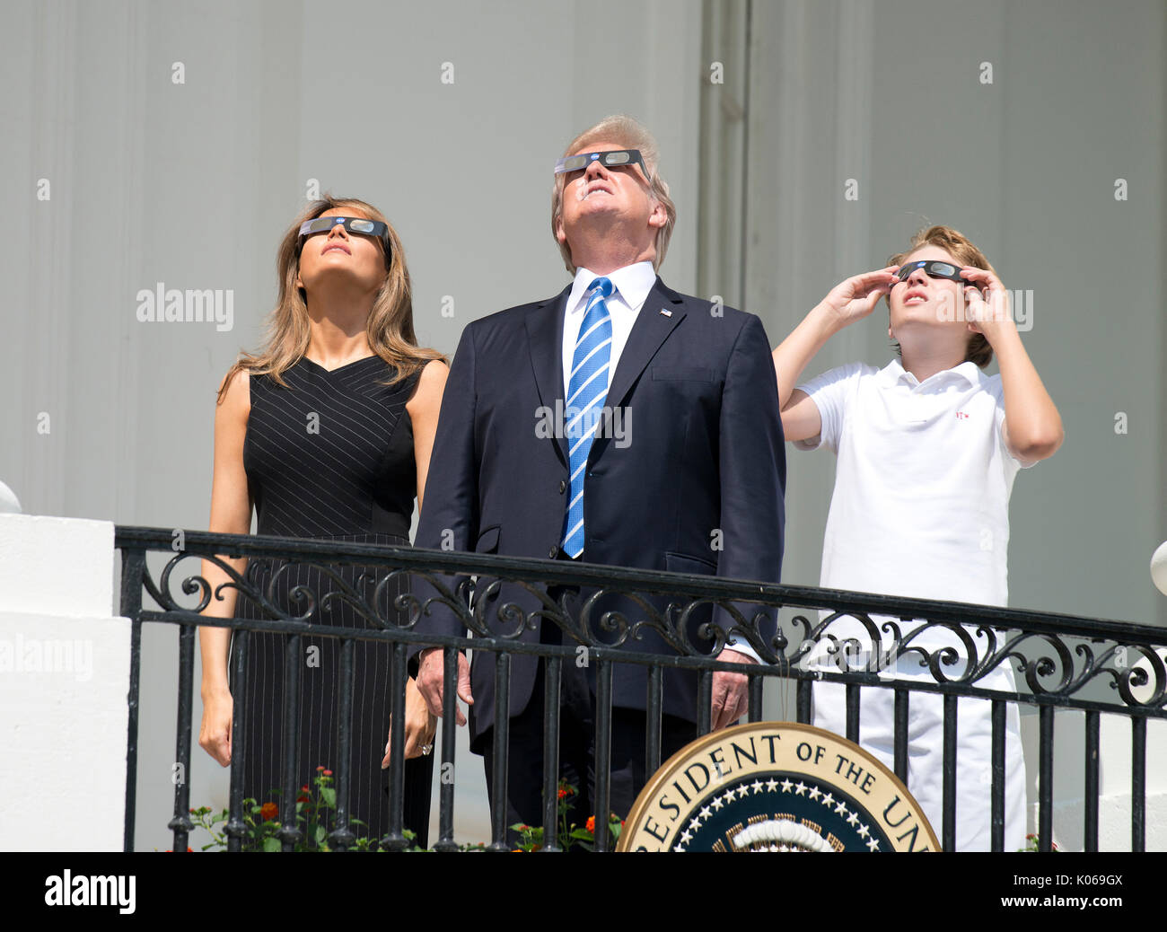 United States President Donald J. Trump, center, accompanied by first lady Melania Trump, left, and Barron Trump, - Stock Image