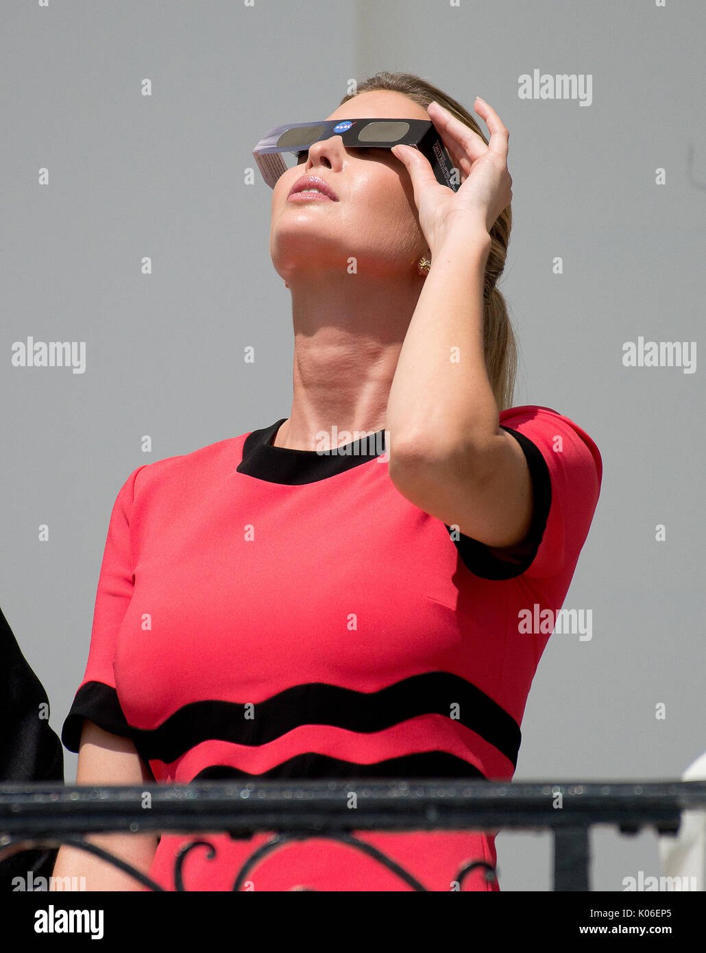Ivanka Trump looks at the partial eclipse of the sun from the Blue Room Balcony of the White House in Washington, - Stock Image