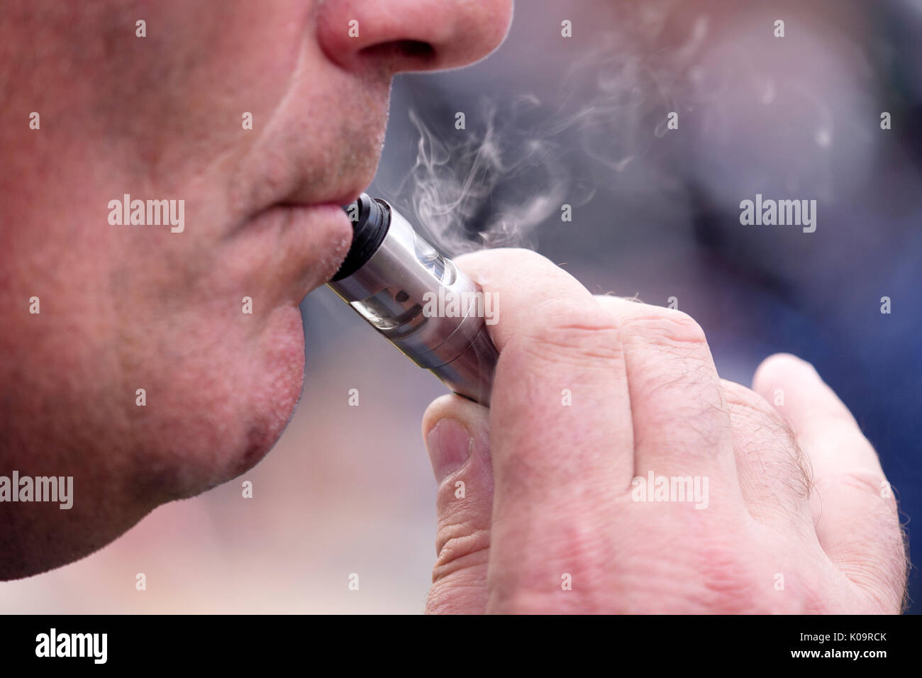 Man using an e-cigarette Stock Photo