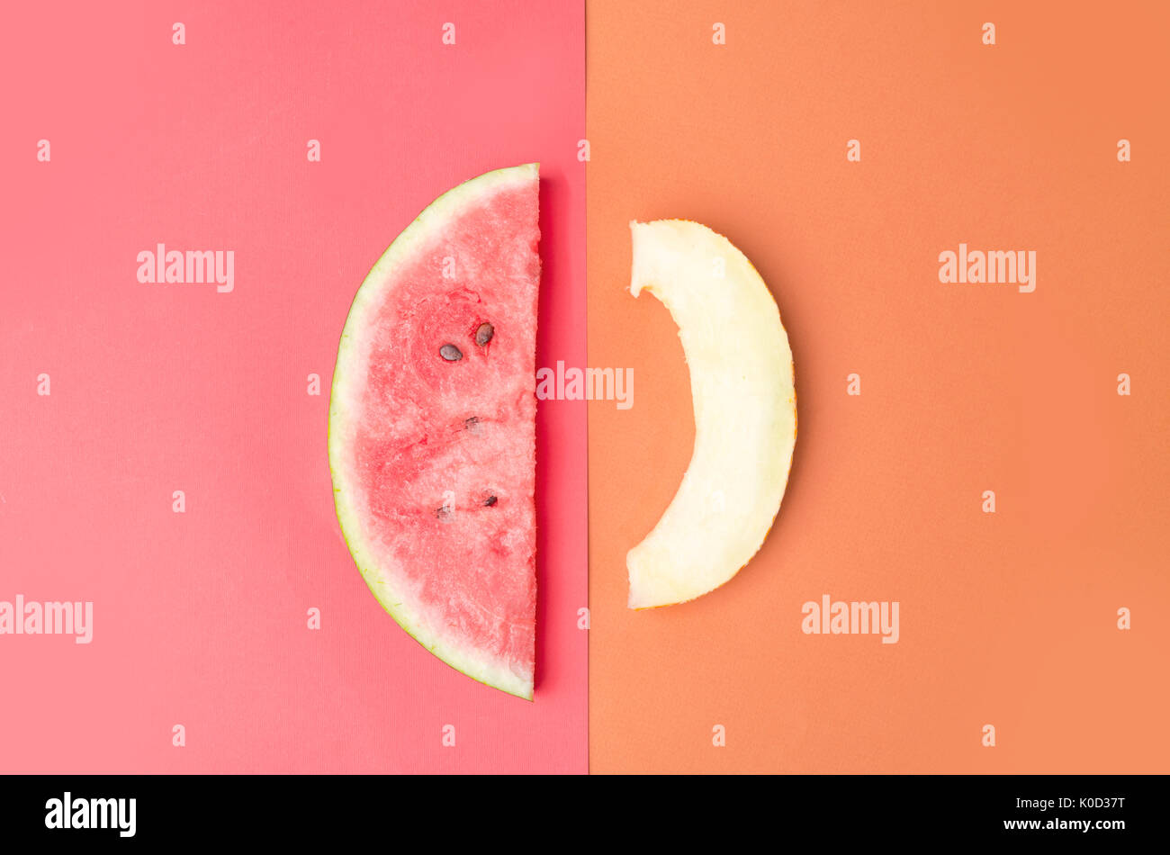 Slice of watermelon with stones on red background and melon isolated over orange background - Stock Image