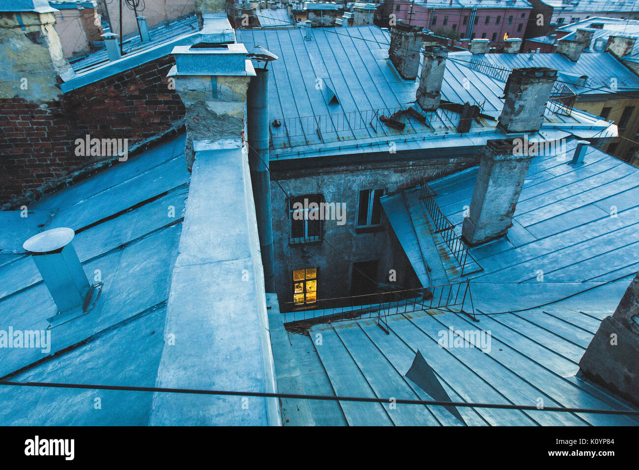 Roofs of old Saint-Petersburg, city view in twilight - Stock Image