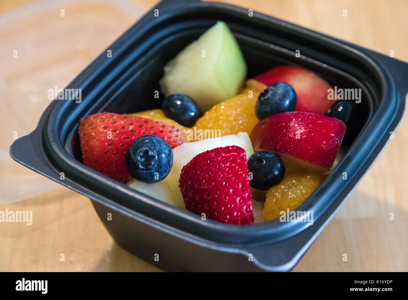 A fresh fruit cup side item offers a healthy and delicious option at Chick-fil-A restaurants, the top-rated quick - Stock Image