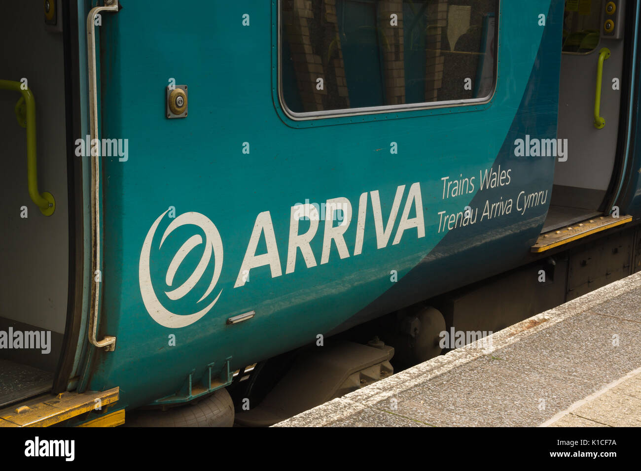 Arriva Trains Wales or Trenau Arriva Cymru logo on passenger train the company provides bus and rail services throughout Stock Photo