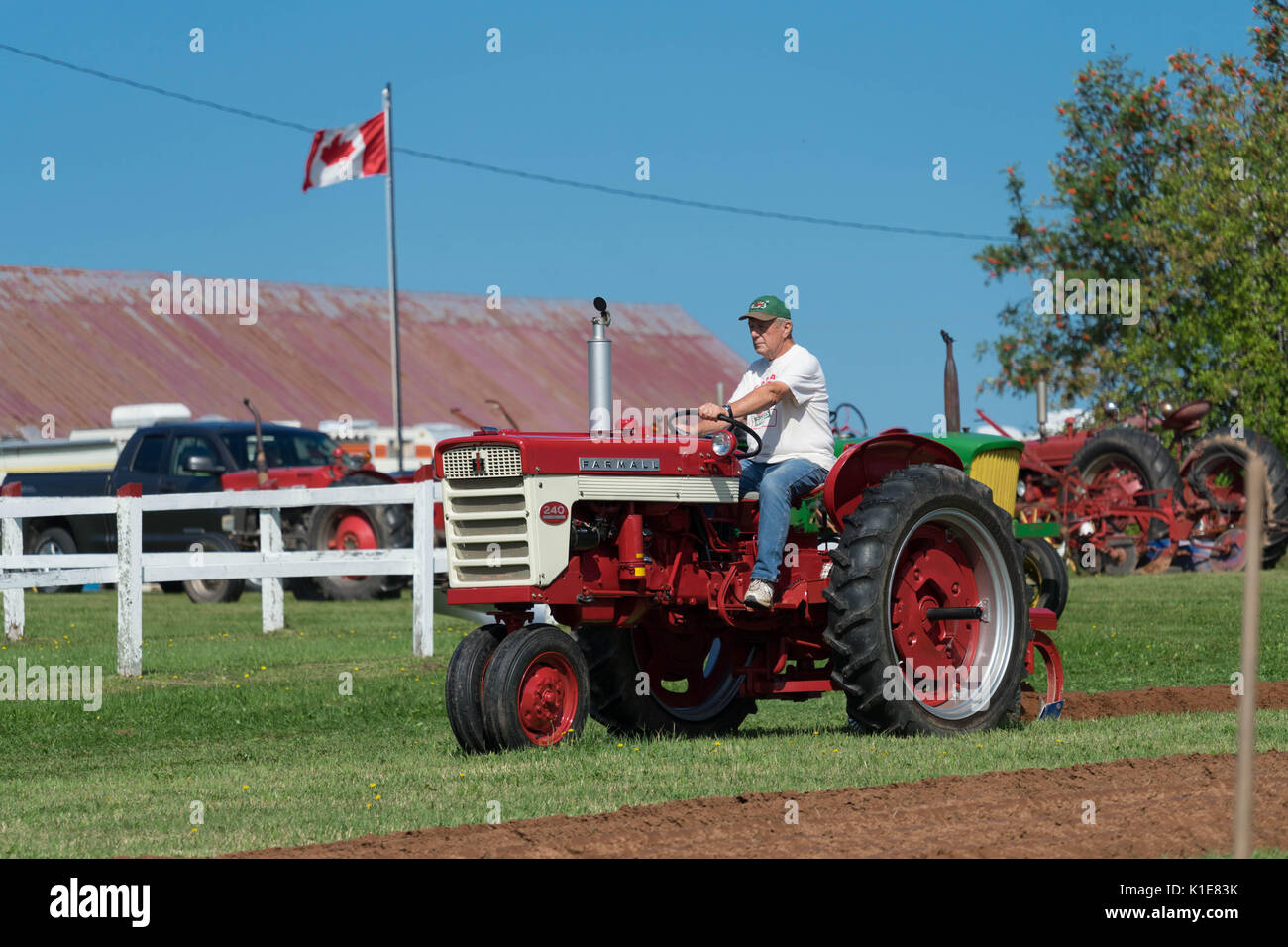 DUNDAS, PRINCE EDWARD ISLAND, CANADA - 25 Aug: Competitors plow with amtique tractors at the PEI Plowing Match and - Stock Image