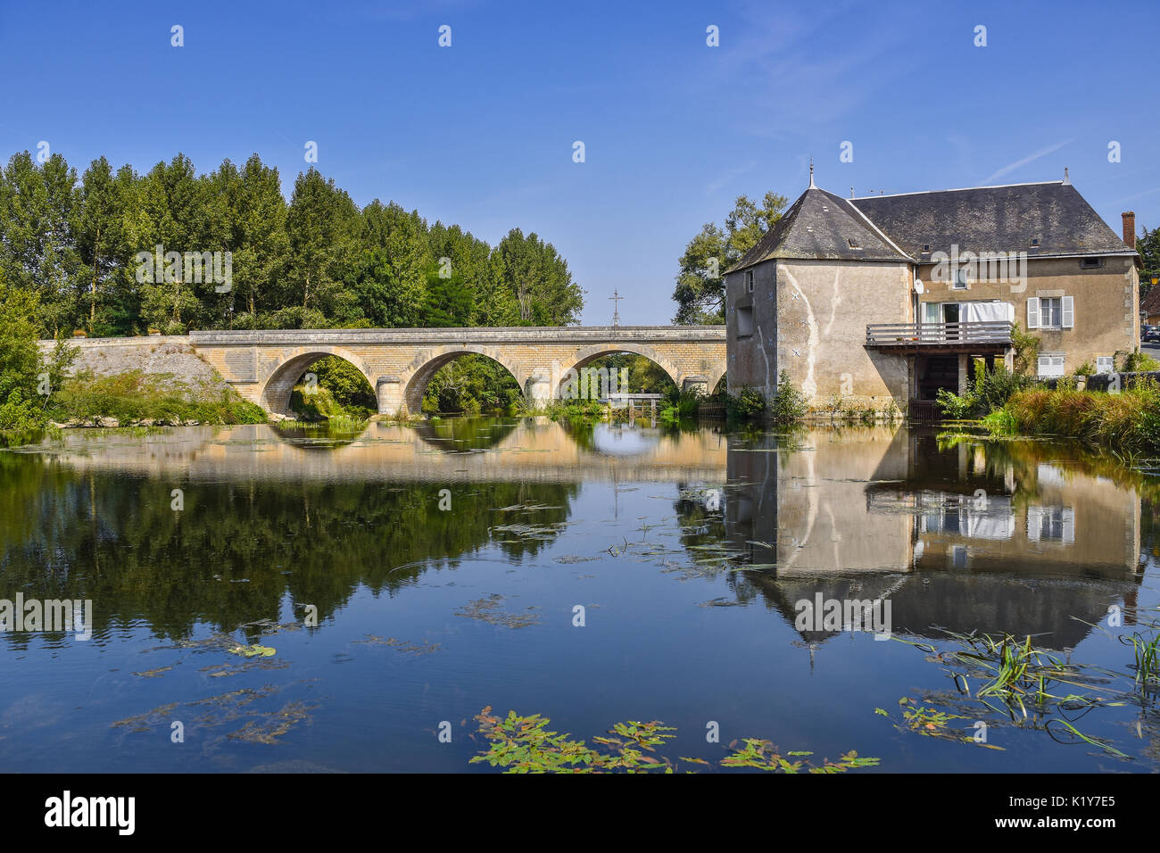 Watermill and bridge across river Gartempe, Saint-Pierre-de-Maillé, Vienne, France. - Stock Image