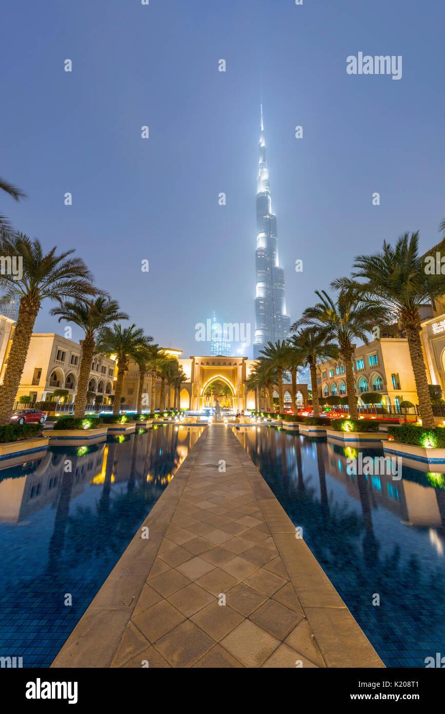 Palm trees and fountains, Burj Khalifa, blue hour, Dubai, Emirate Dubai, United Arab Emirates - Stock Image