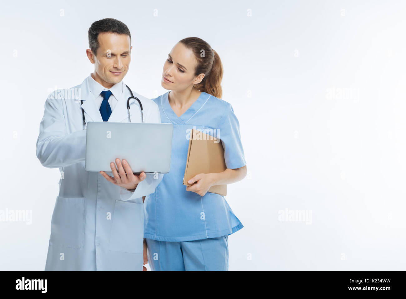 Interested medical workers looking at laptop - Stock Image