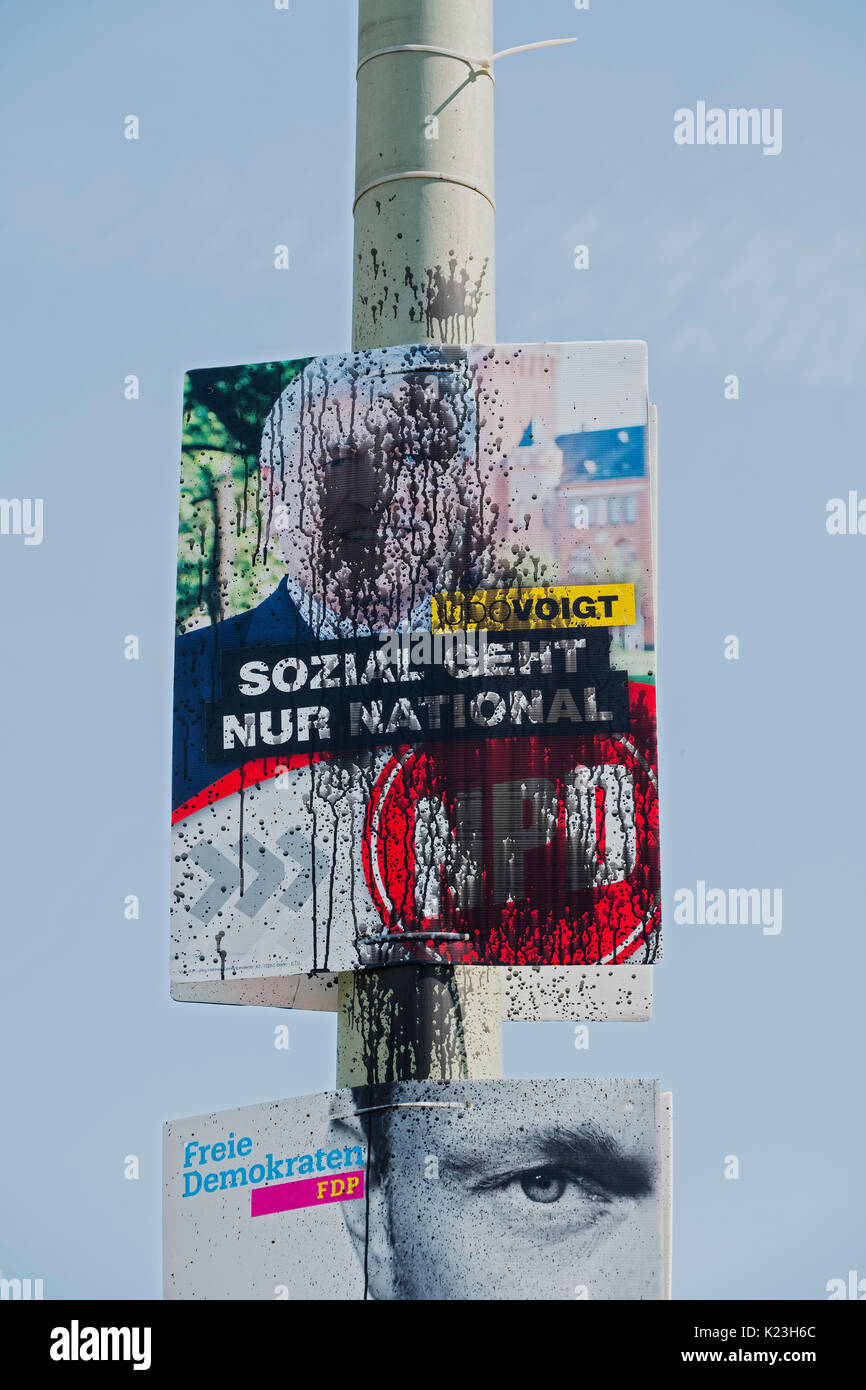 Berlin, Germany. 28th August 2017. Defaced party political poster for far-right neo-Nazi NPD party, National Democratic - Stock Image