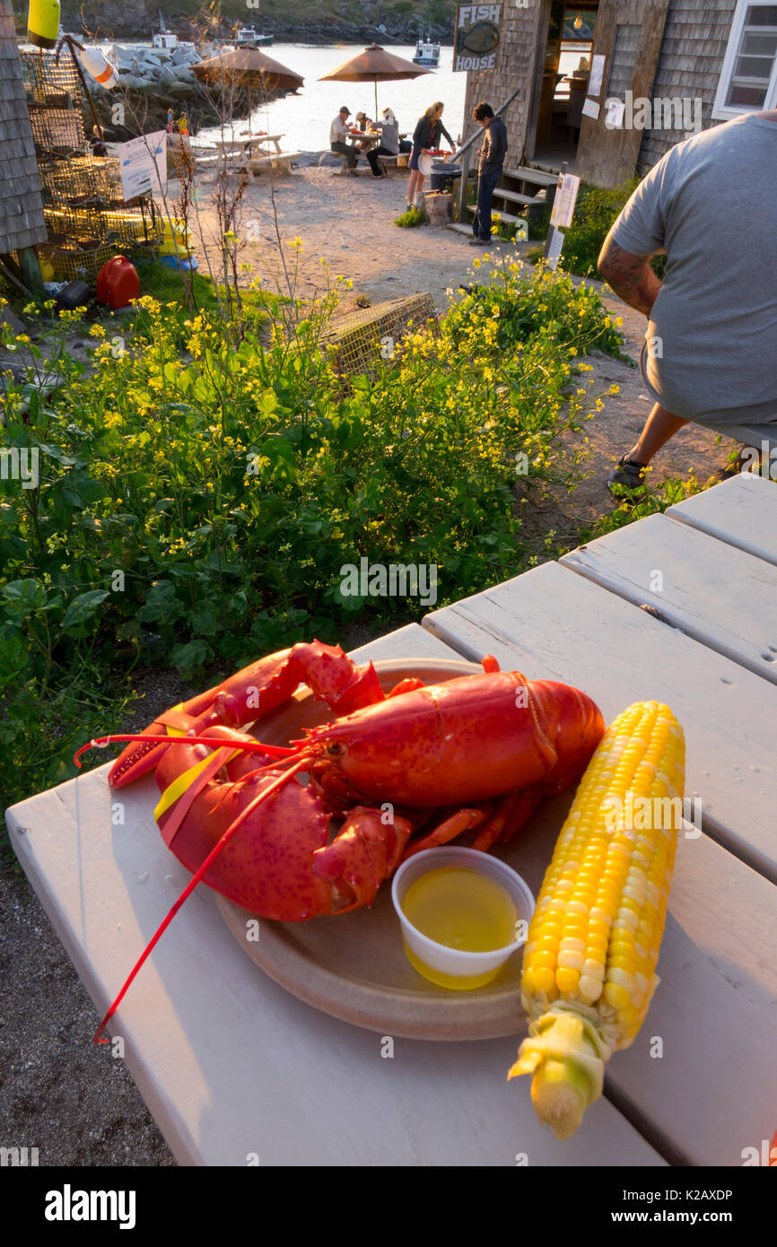 USA Maine ME Monhegan Island a lobster dinner with corn at Fish House restaurant at Fish Beach Stock Photo