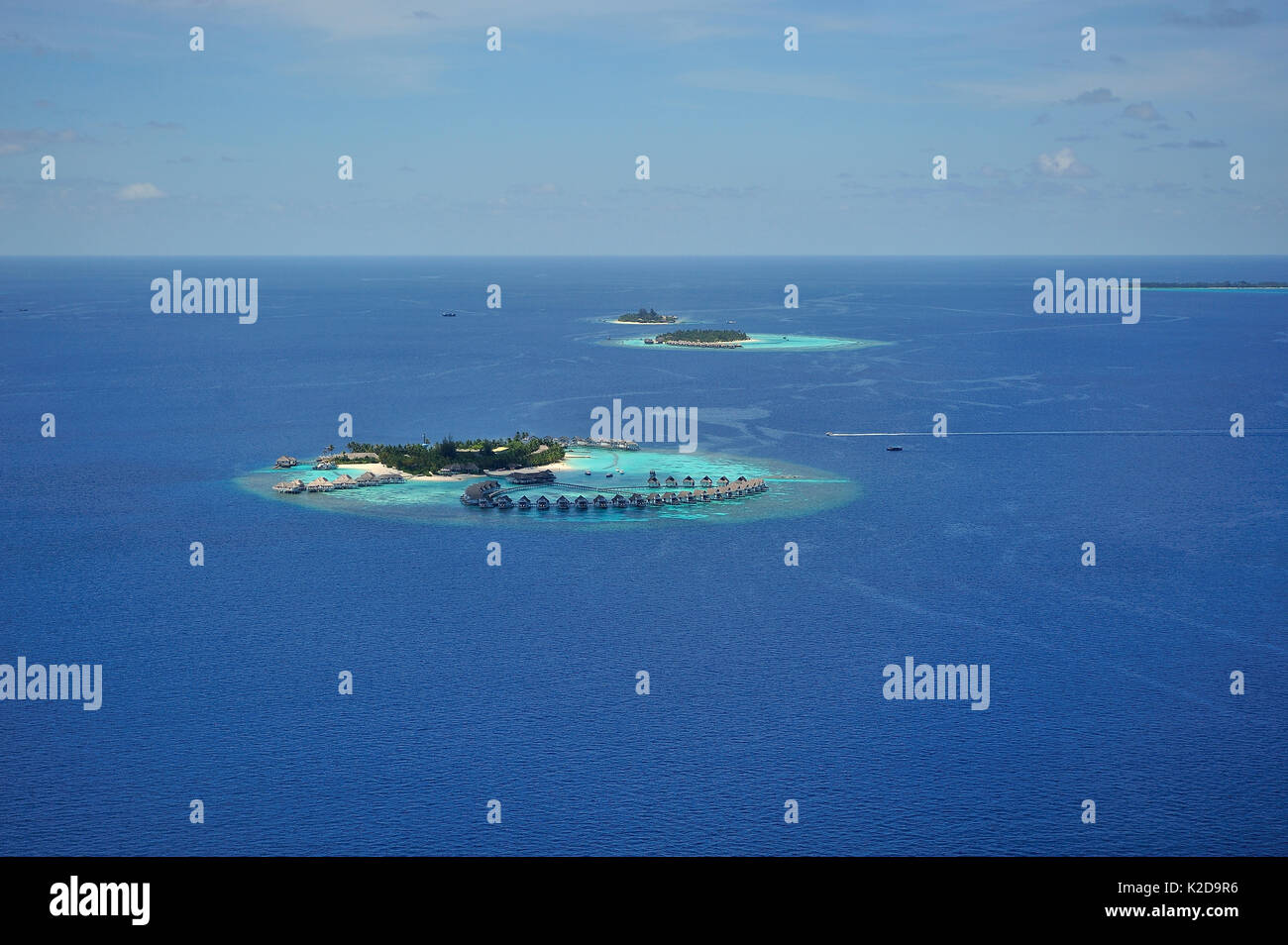 Aerial view of the islets and the lagoons which make the atoll, Maldives, Indian Ocean - Stock Image