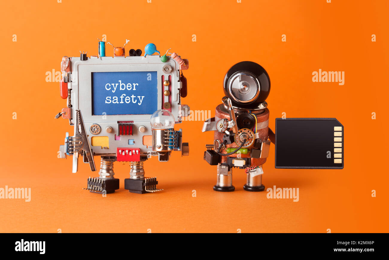 Cyber safety internet crime security concept. Alert message hacked computer. Robotic IT specialist memory card antivirus - Stock Image