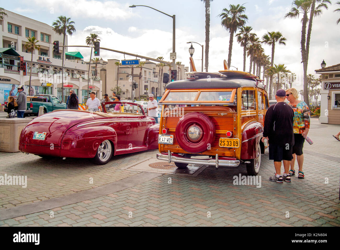 A 1947 Ford convertible and 1947 Ford Super Deluxe 'woodie' station wagon are on display at a classic car - Stock Image