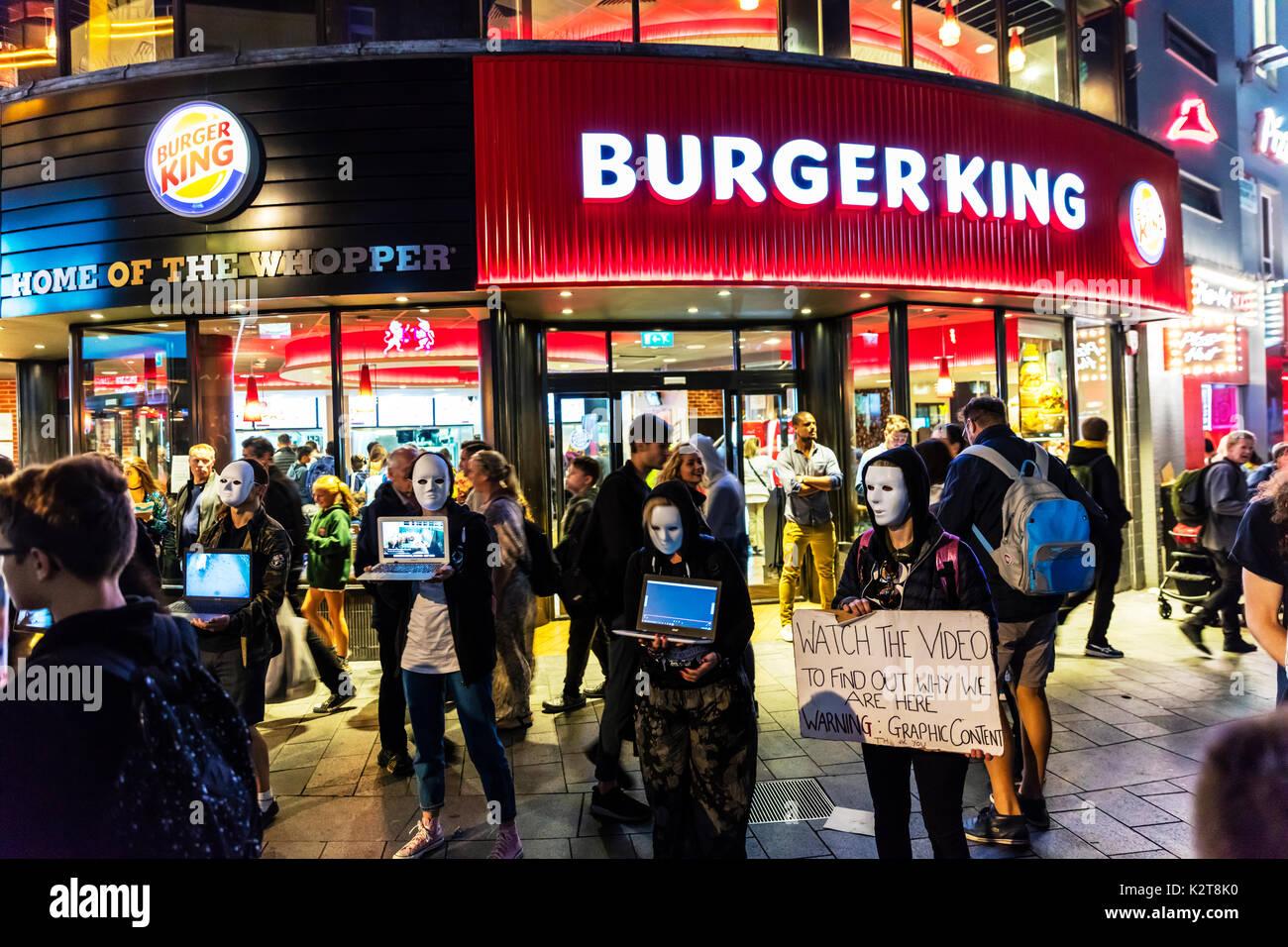 Vegan protesters Leicester Square London, Vegan protesters outside Burger King, Vegan protesters outside Burger - Stock Image