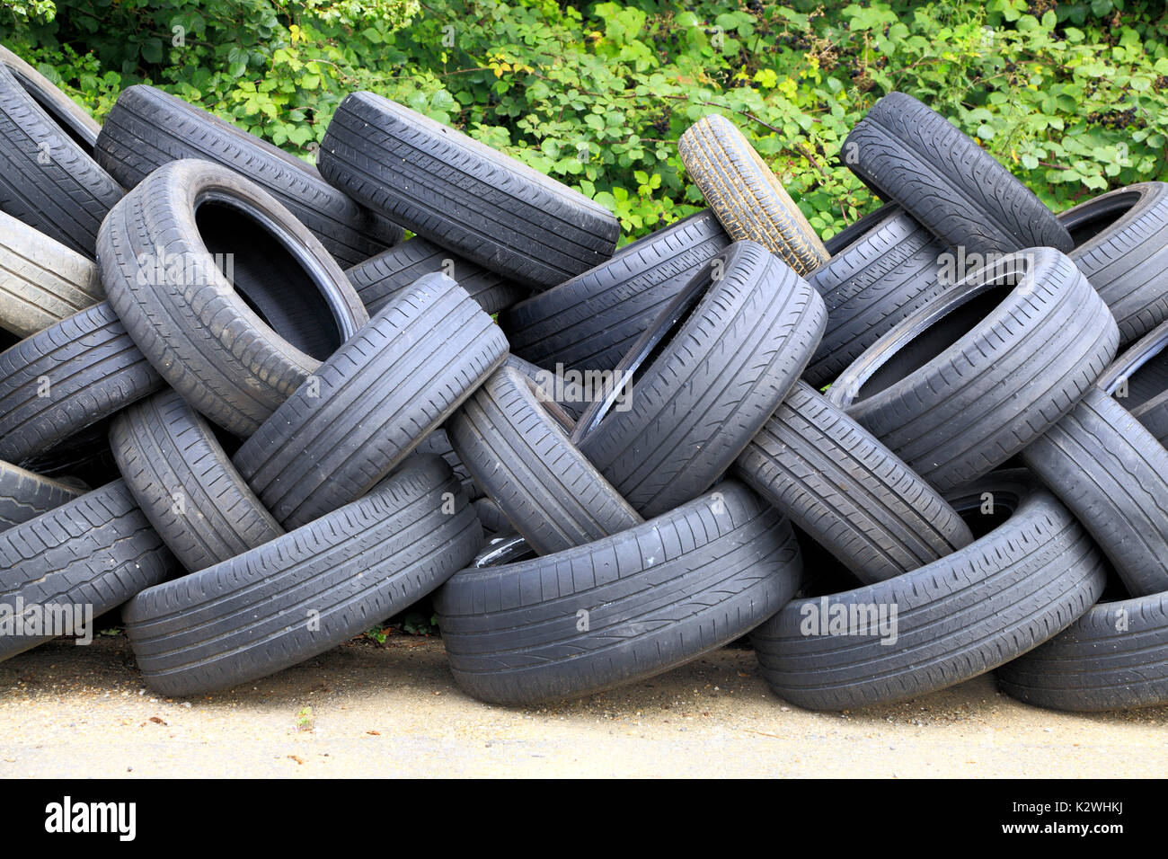 worn, old, motor car tyres, for recycling, England, UK - Stock Image