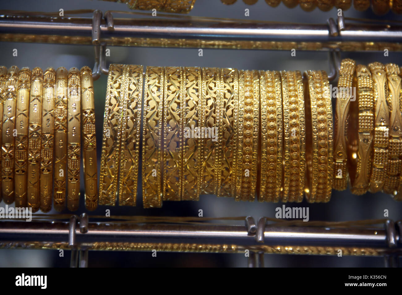 Precious gold bangles made in ethnic delicate designs and patterns - Stock Image