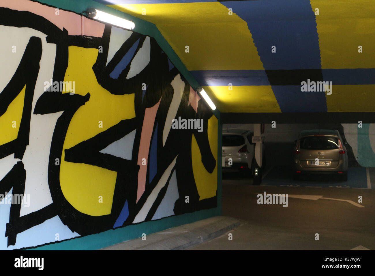 Car park in Saint Gervais Les Bains decorated by Will Gates (MSK) a British artist. - Stock Image
