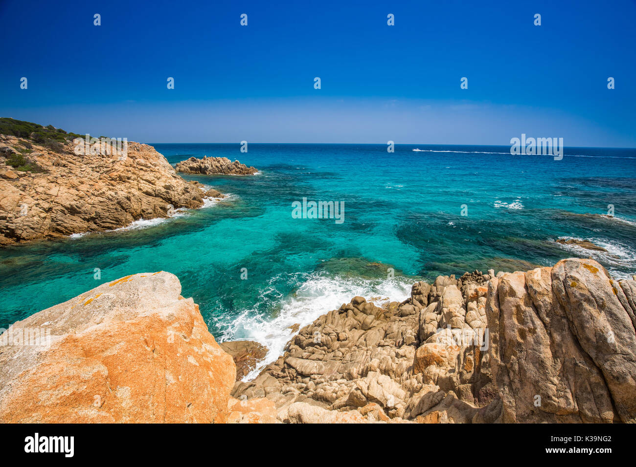 Chia Beach With Red Stones And Azure Clear Water Sardinia Is The