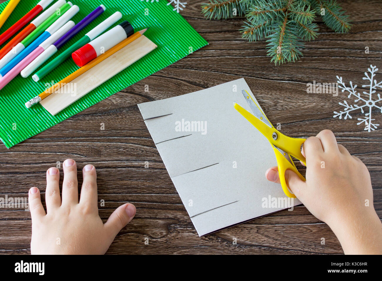A Child Draws A Greeting Card Details With Christmas Presents Made