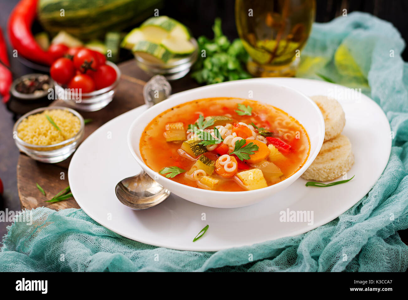 Minestrone - 'big soup', soup with many ingredients - a dish of Italian cuisine, light seasonal vegetable - Stock Image