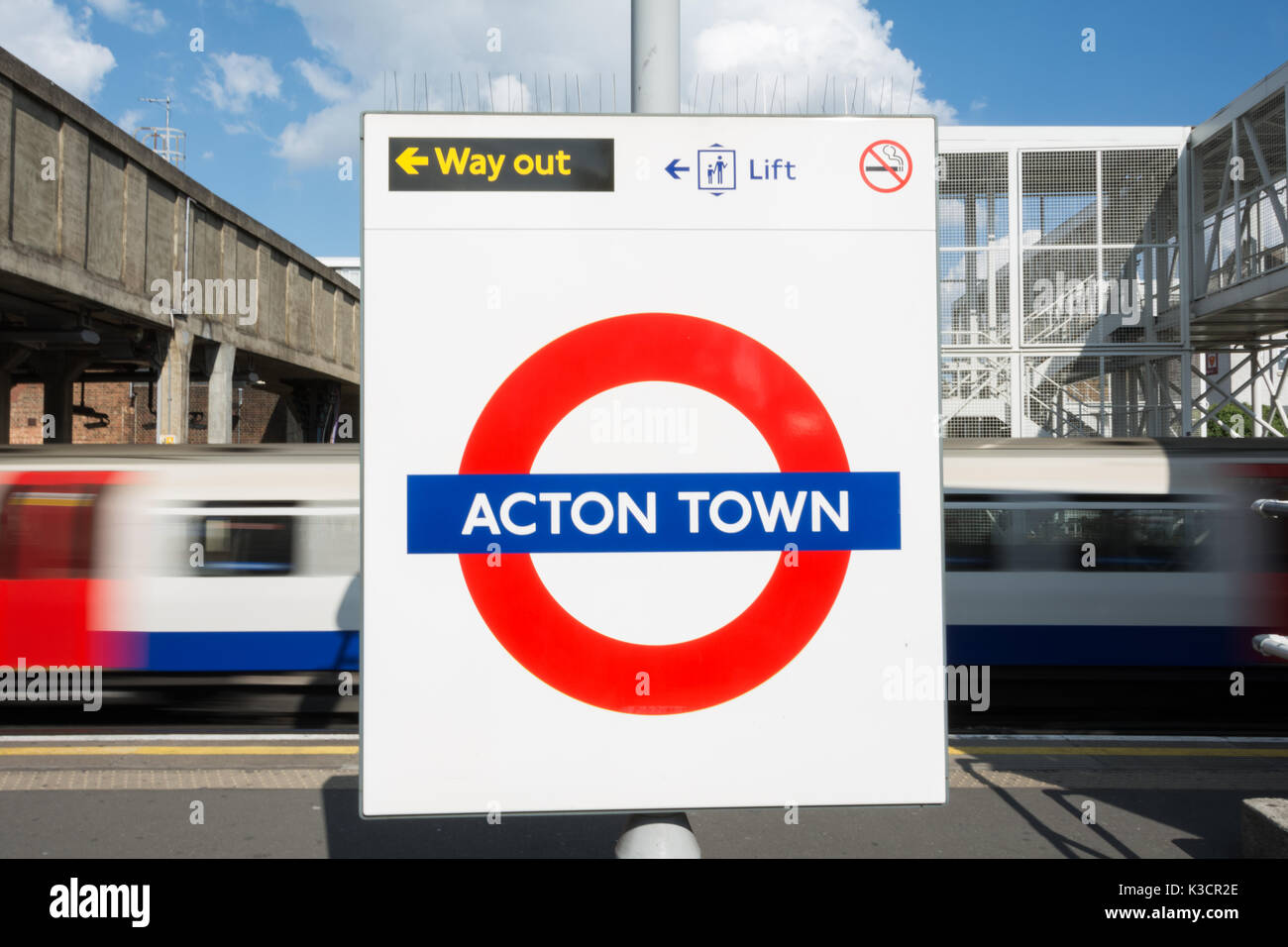 Roundel on the platform at Acton Town underground station in west London, UK Stock Photo