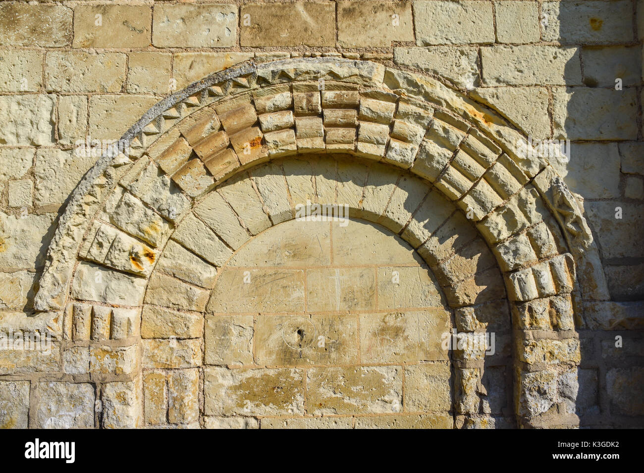 Old carved stone church doorway arch, Bossay-sur-Claise, France. - Stock Image