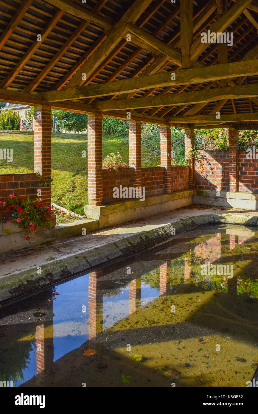Interior of lavoir (public wash-house), Bossay-sur-Claise, France. - Stock Image