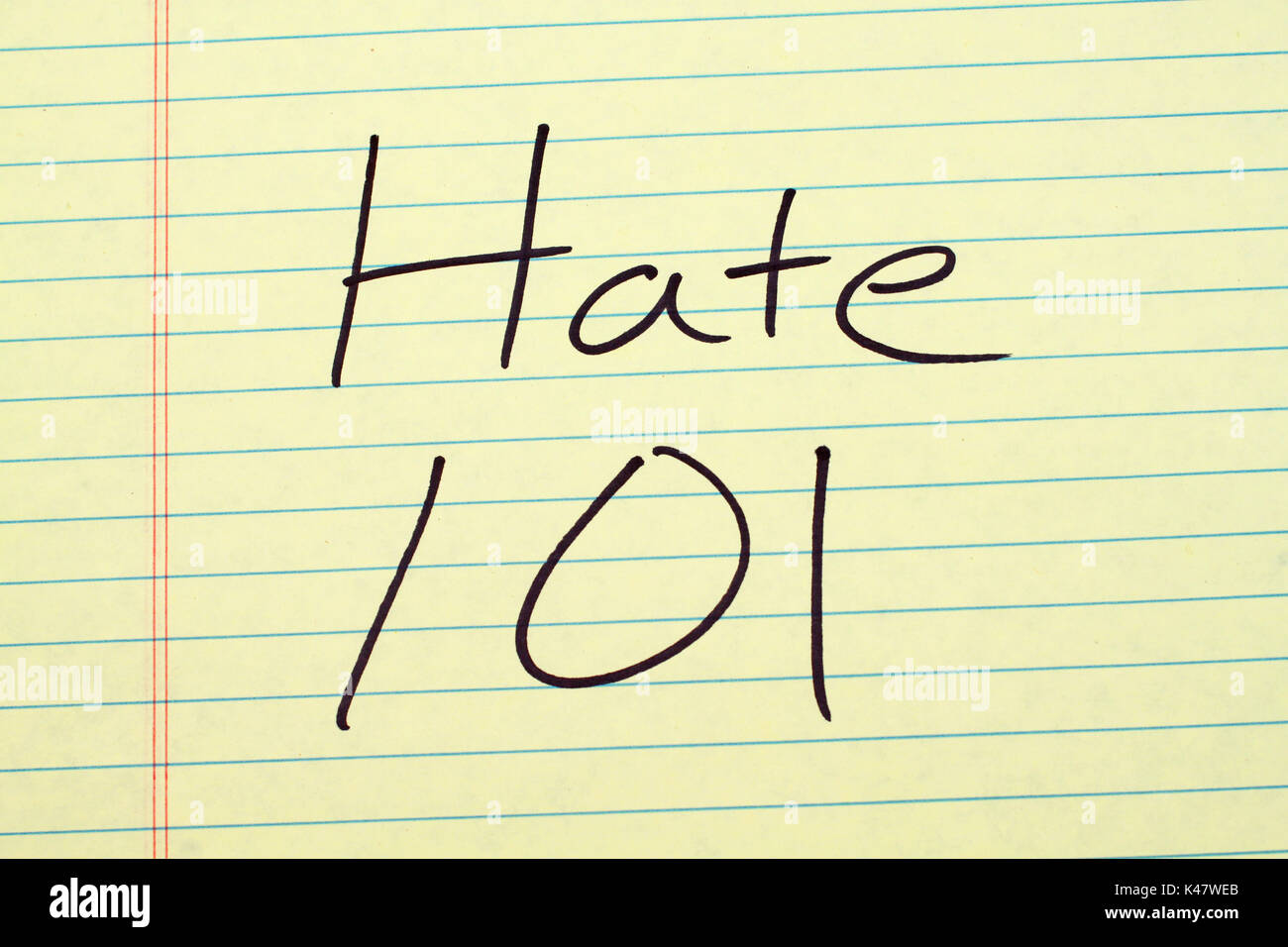 The words 'Hate 101' on a yellow legal pad - Stock Image