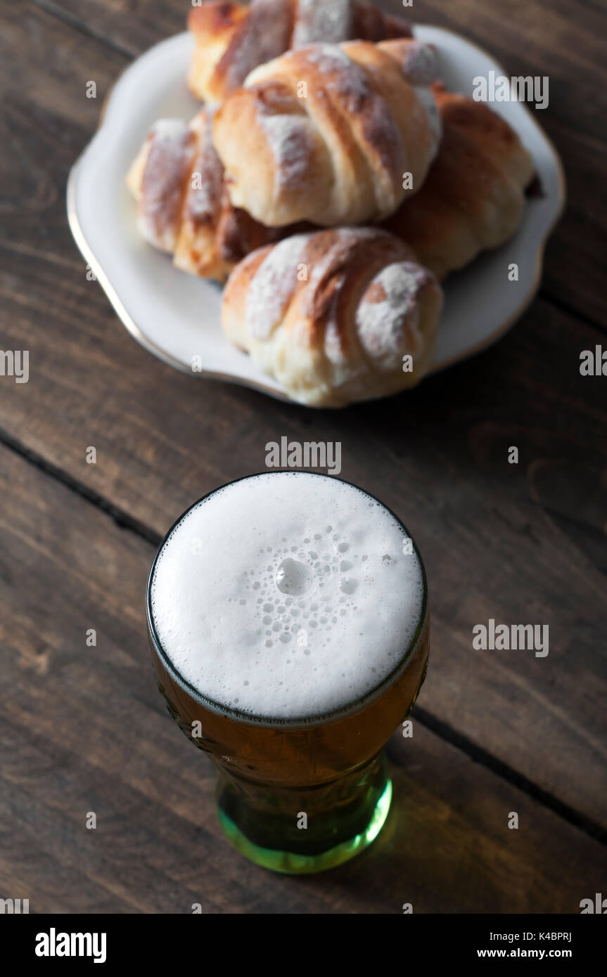 Beer glass on a wooden table, from above - Stock Image