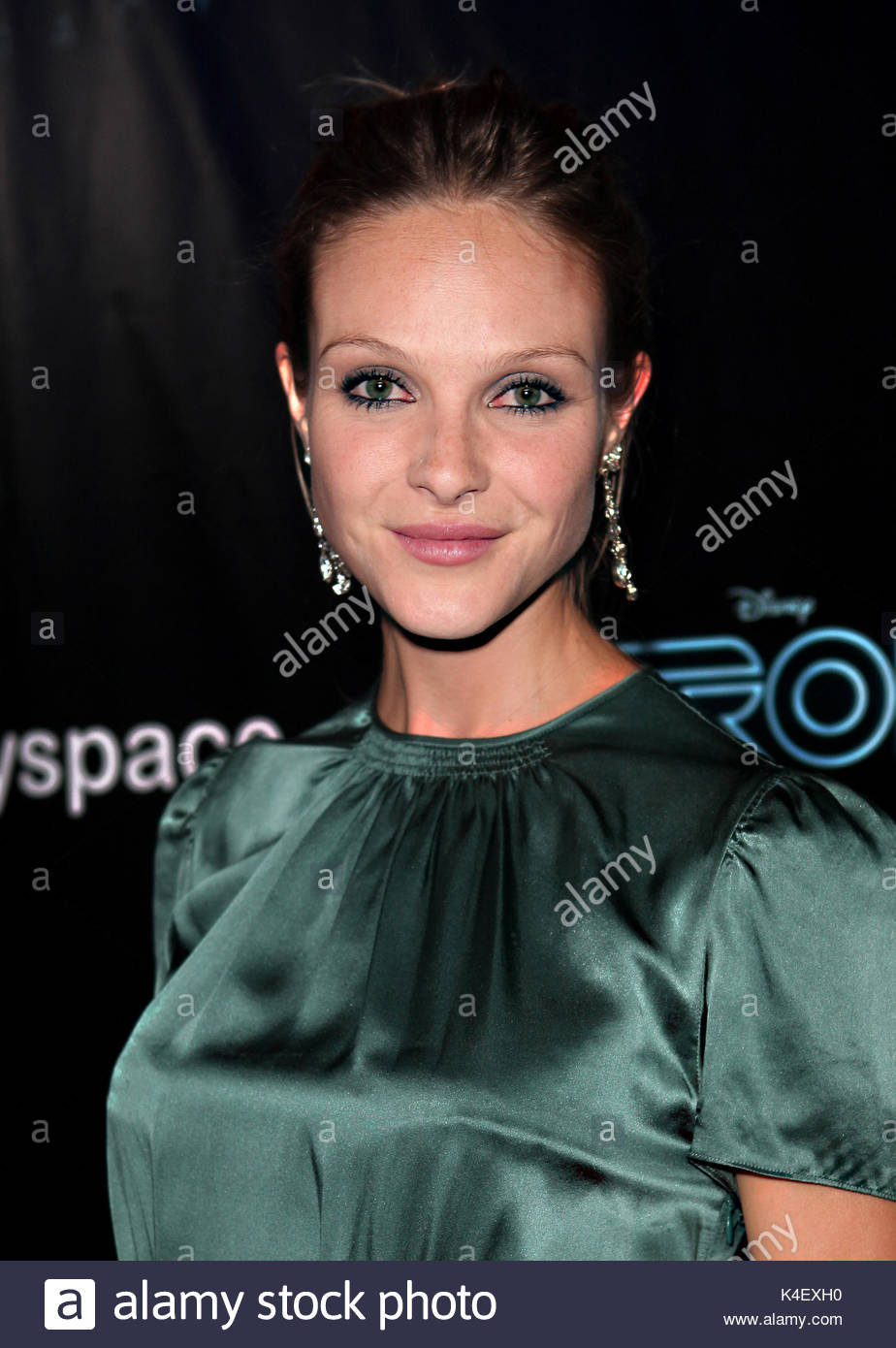 beau garrett. celebrities attend disney's tron legacy party at stock