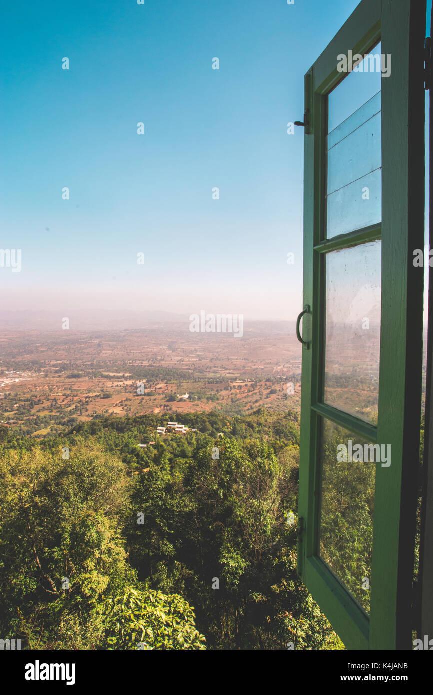 Looking out through an open window overlooking Lake Pindaya in Shan State, Myanmar (Burma) 2013. - Stock Image