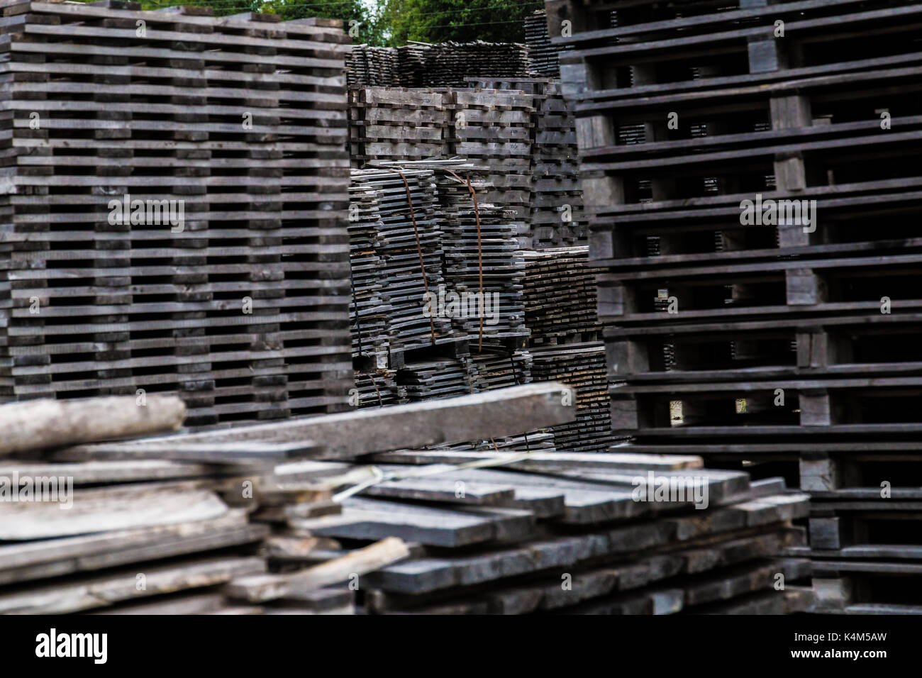 Piled of old and gray timber planks - Stock Image