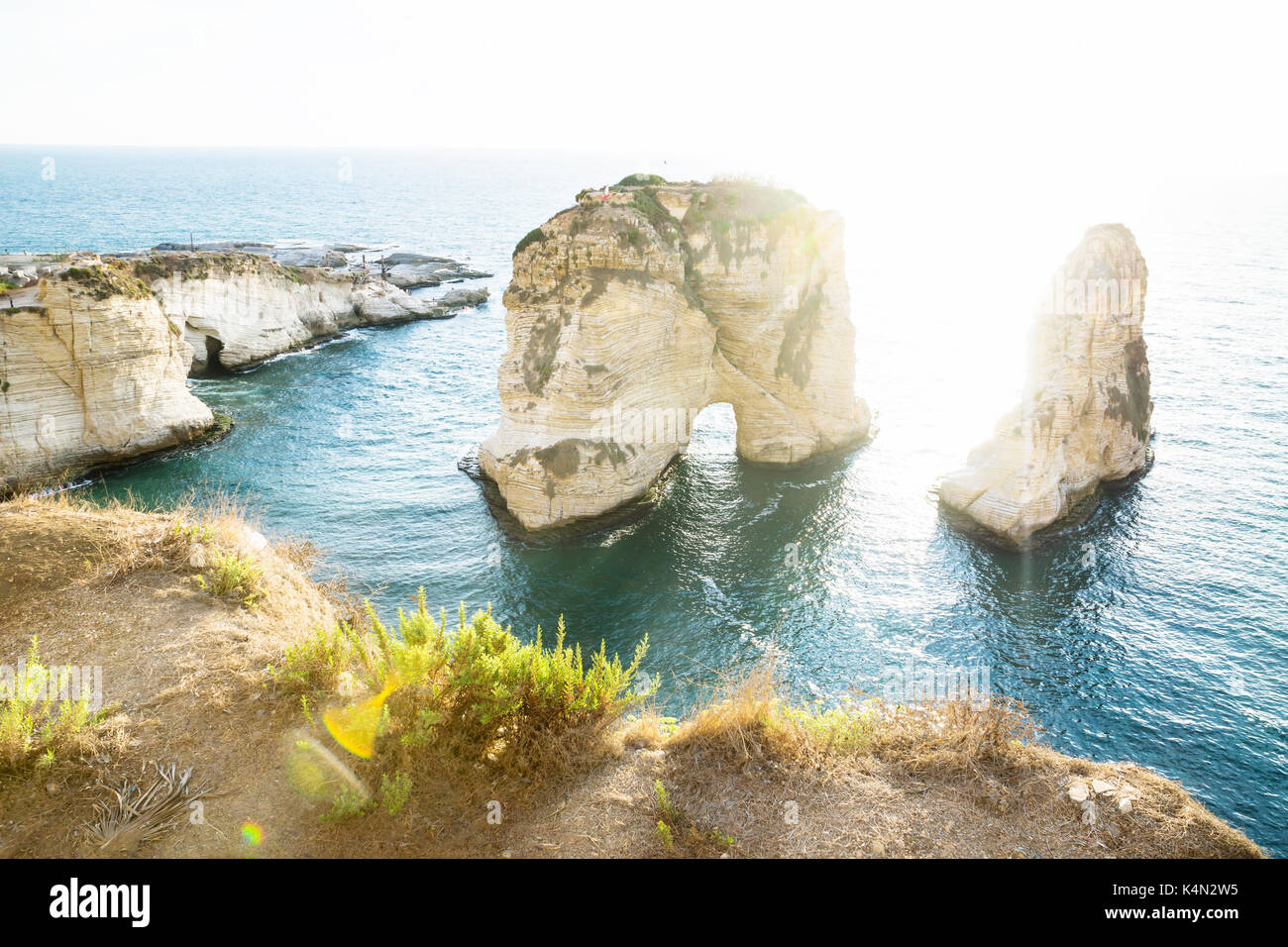Pigeon rock with backlight sunlight, Beirut, Lebanon - Stock Image